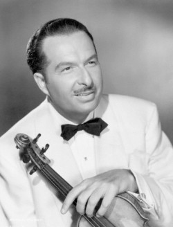"Original caption: Picture shows Xavier Cugat, he became known as the ""Rhumba King,"" and he and his famous band were greatly responsible for the popularity of the ""Rhumba,"" ""Samba"" and the ""Conga."" Undated photo circa 1940s-50s. --- Image by © Underwood & Underwood/Corbis"