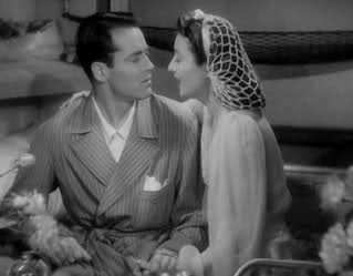 "Barbara Stanwyck with Henry Fonda in ""The Lady Eve"" (1941) wearing a snood."