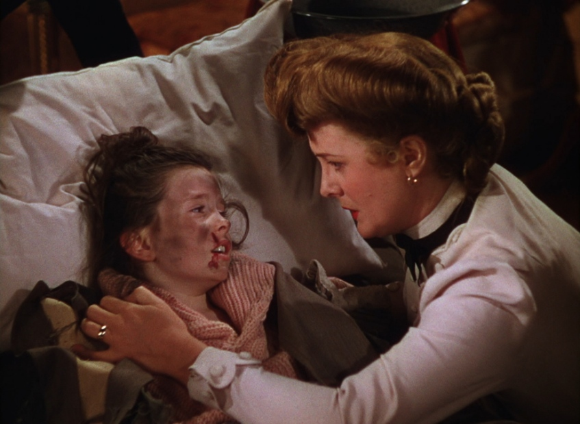 O'Brien as Tootie telling lies to Mary Astor, playing her mother-saying that John Truitt tried to kill her on Halloween.