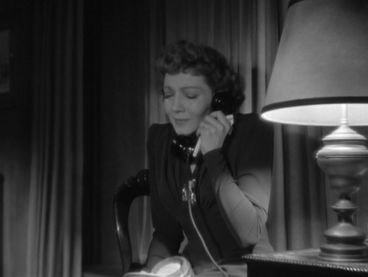 Anne Hilton (Claudette Colbert) receiving the cable gram that her husband is home safe. -screen capped by the Hollywood Comet