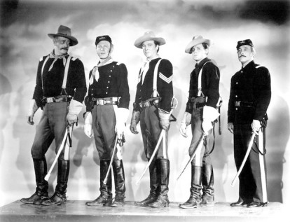 "John Wayne, Harry Carey Jr., Ben Johnson, John Agar and George O'Brien on the set of ""She Wore a Yellow Ribbon""."