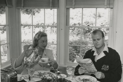 Newly weds child star Bonita Granville and producer husband Jack Wrather at the breakfast table