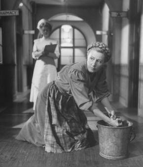 Mama (Irene Dunne) pretends to be a wash woman in the hospital to see her daughter, Dagmar. (LIFE photo by Allan Grant)