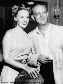 "Bandleader Kay Kyser with his wife and girl singer, ""Gorgeous"" Georgia Carroll"