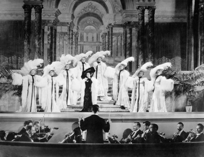 "Luise Rainer (center in black) performing ""It's Delightful to Be Married."""
