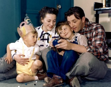 Robert Mitchum in 1945 with his wife Dorothy and sons, Christopher and James