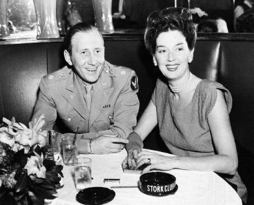 Rosalind Russell and Frederick Brisson at the Stork Club after Brisson returned from Europe, serving as General Arnold's chief of radio activities during the war. (1941)