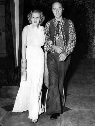 Harlow with fiance William Powell at William Randolph Hearst's birthday party in 1936