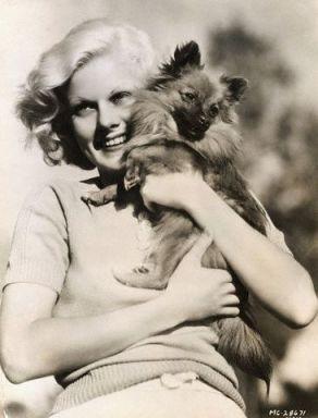 Jean Harlow hugging her Pomeranian, Oscar