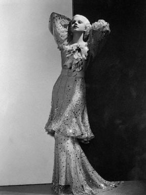 Harlow in 1933. A gold and sequined gown with an Oriental influence