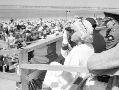 Watching the National Air Races of Los Angeles Municipal Airport in 1933. She raised the flag tobegin the races.
