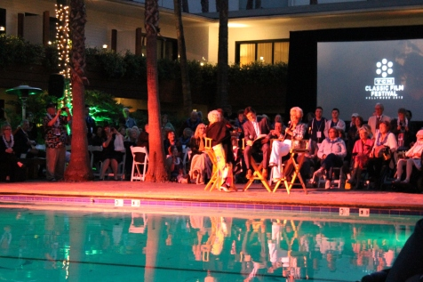 France Nuyen, Ben Mankiewiczi and Mitzi Gaynor poolside at the Roosevelt Hotel