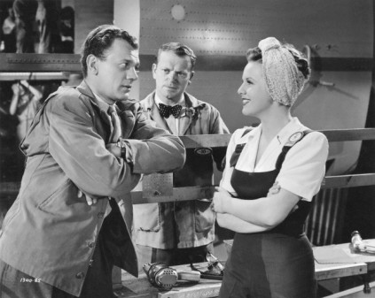 "Cotten and Durbin in a scene in ""Her's to Hold"" with Murray Alper in the background."