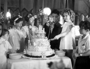 Shirley Temple cutting the cake at her birthday party in 1935.