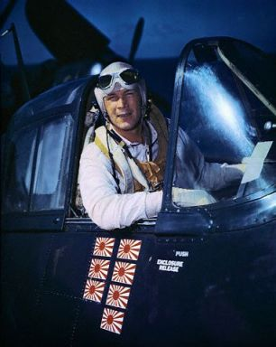 "Morris in 1944 in his plane ""Meatball."" The decals show how many Japanese planes he shot down."
