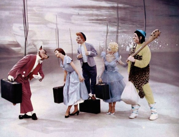 Lili dances with life size puppets during a dream sequence.