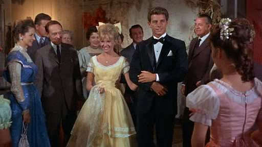 """Nancy (Mills) enters the Halloween party with handsome Tom Hamilton (Peter Brown) in """"Summer Magic"""""""