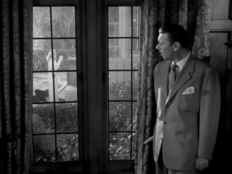 "Reporter George Brent investigates a murder in ""A Corpse Came C.O.D."""