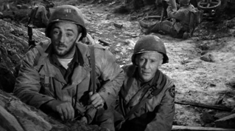 "Robert Mitchum and Burgess Meredith (as Ernie Pyle) in World War II film ""The Story of G.I. Joe"" about reporting on the front lines."