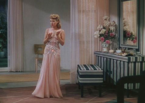 Lovely peach evening gown worn by Grable. (Comet Over Hollywood/Screen cap by Jessica P)