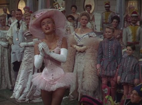 Patti (Powell) dreams of being a grown up lady who wears a corset in this dream sequence. (Comet Over Hollywood/Screen Cap by Jessica P.)