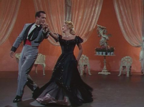 Patti (Powell) dances the tango with Demi (Montalban) in the resort's talent show. (Comet Over Hollywood/ Screen Cap by Jessica Pickens)