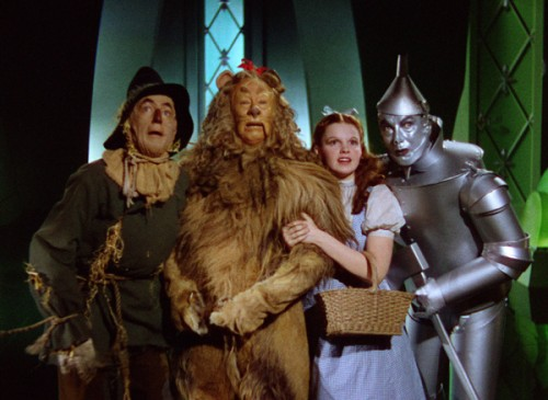"Ray Bolger as the Scarecrow, Bert Lahr as the Cowardly Lion, Judy Garland as Dorothy and Jack Haley as the Tin Man in ""The Wizard of Oz"""
