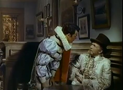 Philippe and Jesse look ridiculous dressed in French costumes (after a masquerade) in a saloon. Comet Over Hollywood/Screen Cap by Jessica P.