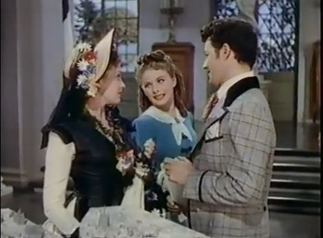 Edith (Darnell) and Julia (Craine) compete for the attentions of Phillippe (Wilde). Comet Over Hollywood/ Screencap by Jessica P.