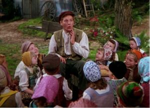 Danny Kaye as Hans Christian Anderson tells stories to village children.