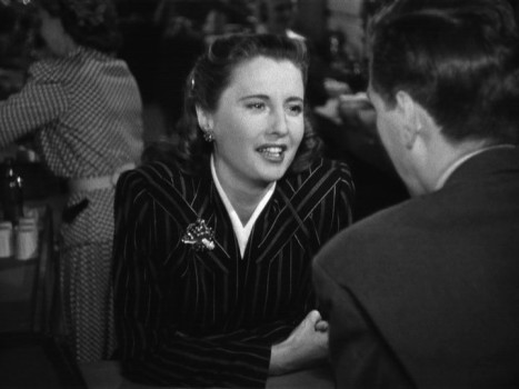 Robert Hutton speaks with Barbara Stanwyck during her cameo.
