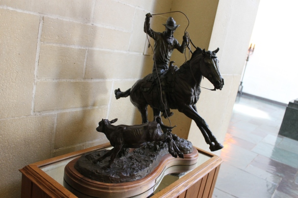 Small sculpture of Rogers roping a calf