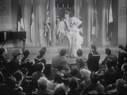 Gypse Rose Lee performs for the soldiers at the Stage Door Canteen
