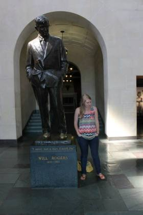 Posing with Will Rogers's statue