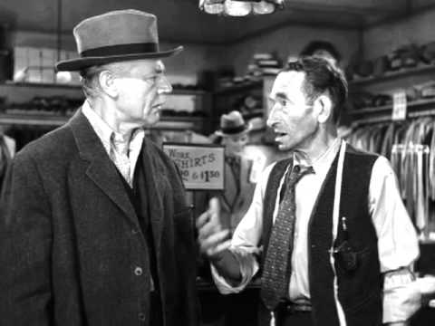 Wealthy Michael O'Connor (Charles Ruggles) exchanges his fancy clothes to dress like he is homeless.