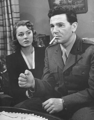 "Parker helps husband John Garfield adjust to living life without sight in ""Pride of the Marines"" (1945). (LIFE)"