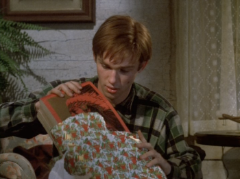 John Boy receives writing tablets for Christmas from his father.