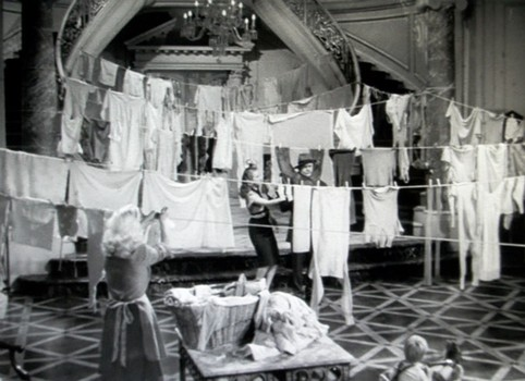 Wives of Jim's Army buddies use the foyer of the O'Connor home for hanging laundry as the house gets more crowded.