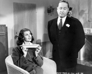 "Robert Benchley tries to woo Rita Hayworth with a bracelet in ""You'll Never Get Rich"""