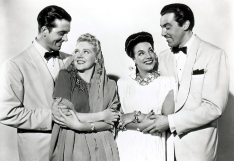 "John Payne, Alice Faye, Carmen Miranda and Cesar Romero in ""Week-End in Havana."""