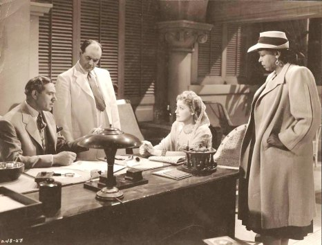 Jeanette MacDonald is worried Robert Young has fallen into hands of spies. Also pictured- Ethel Waters and Rhys Williams.