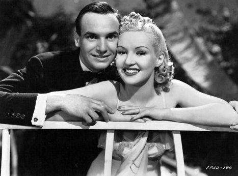 "Jackie Coogan and Betty Grable in ""College Swing"" (1938)"