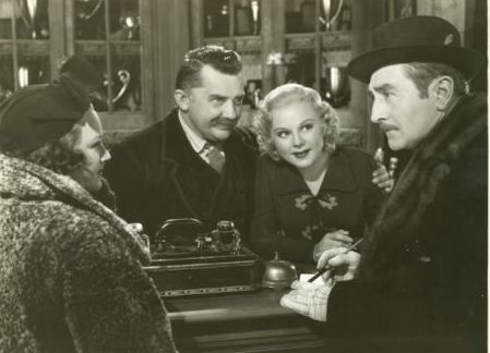 "Arline Judge and Adolph Monjou check in to an inn run by Jean Hersholt and Sonja Henie in ""One in a Million."""