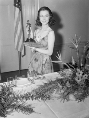 Vivien Leigh proudly holds her Best Actress Oscar on March 2. 1940. She was recognized for her portrayal of Scarlett O'Hara in Gone With the Wind.