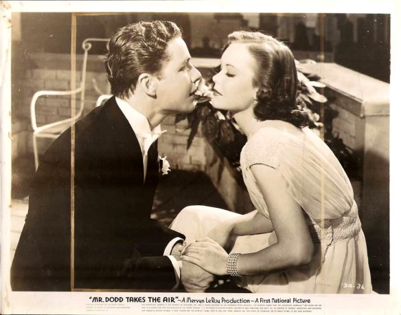 "Kenny Baker and Jane Wyman in ""Mr. Dodd Takes the Air."""