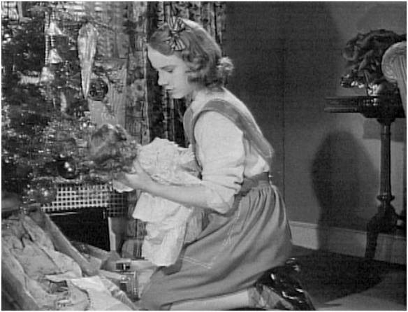 Peggy Ann Garner with the doll on Christmas morning