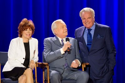 Jill St. John and Robert Wagner celebrating the 20th Anniversary of TCM with Robert Osborne during the Ask Robert Event at The Montalban Theatre on Friday at the 2014 TCM Classic Film Festival In Hollywood, California. 4/11/14  PH: Mark Hill