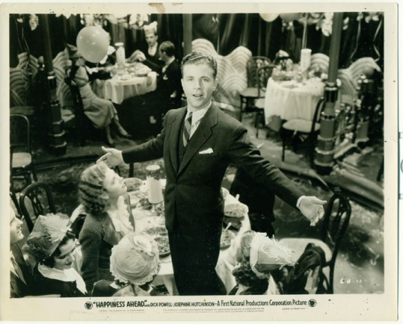 "Dick Powell in a publicity still for ""Happiness Ahead."""