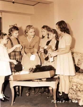 Madeleine Carroll looking after war orphans in her French Chateau