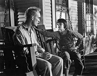 "Scout with Boo Radley in ""To Kill a Mockingbird."""